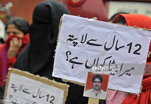 Kashmiri woman attend a protest in capital Srinagar on April 23 held to seek the whereabouts of local handicrafts trader Ghulam Muhammed Sofi who was...