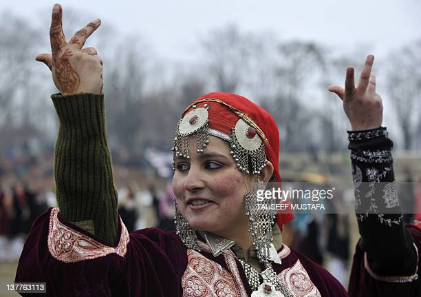 Kashmiri woman dance during a Republic Day parade at the Bakshi stadium in Srinagar on January 26, 2012. Republic Day marks the proclamation of India...