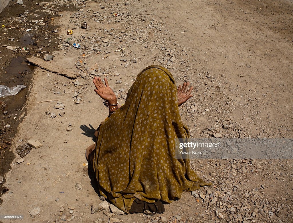 A Kashmiri woman flood victims prays after floods washed away her house in a flooded area on September 17, 2014 in Srinagar, the summer capital of Indian administered Kashmir, India. Nearly 100,000 people are still marooned in the areas of the Kashmir Valley submerged in flood waters. The floods in the Himalayan region of Kashmir were believed to be the worst in decades with over 200 dead. Health experts are worried over the stagnant waters and floating carcasses of livestock could create conditions for serious outbreaks of disease.