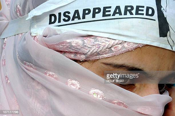 A Kashmiri woman relative of a missing person attends a protest organised by the Association of Parents of Disappeared Persons in Srinagar on...