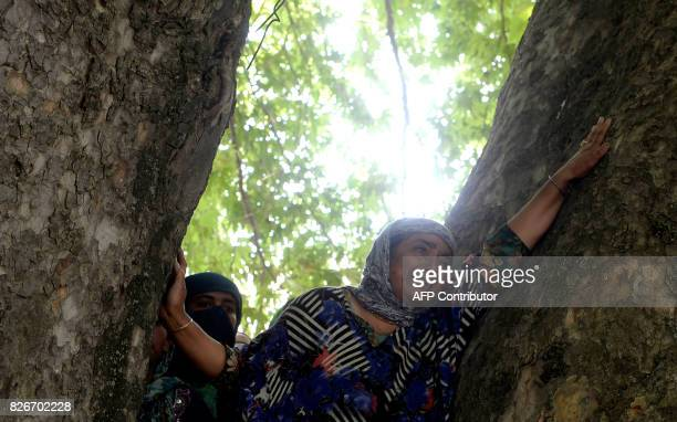 A Kashmiri woman wails as she watches the funeral procession of slain rebel Abid Ahmed in the village of Hajinar in the district Bandipora north of...