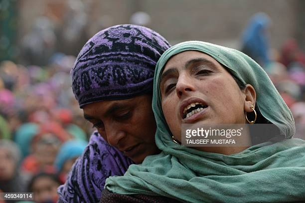 Kashmiri women and children mourn Shiraz Ahmed a suspected rebel during his funeral procession in the village of Panjran in Pulwama District south of...