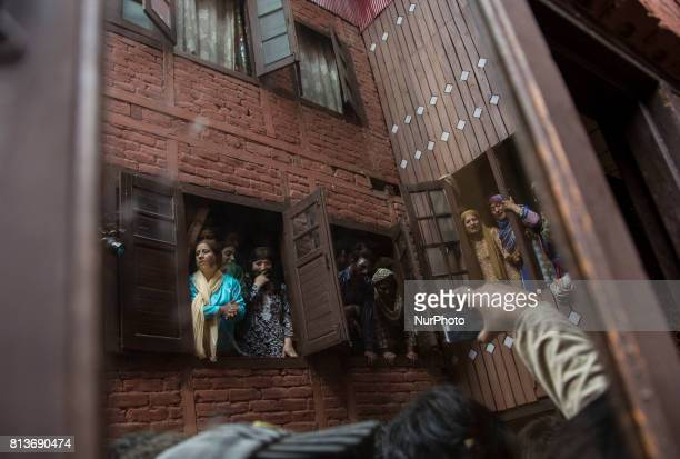 Kashmiri women cry as reflected on a window pane during funeral of a local rebel Sajad Gilkar Wednesday July 12 2017 in Srinagar Indianadministered...