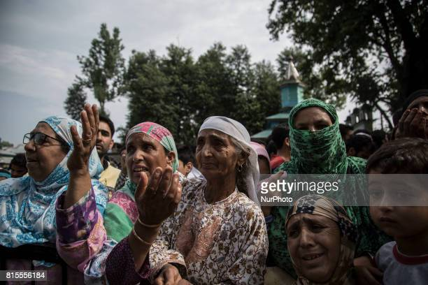Kashmiri women cry during the funeral procession of a local rebel Parvaiz Mir Sunday July 16 in Pohoo village 38 kilometers south of Srinagar...