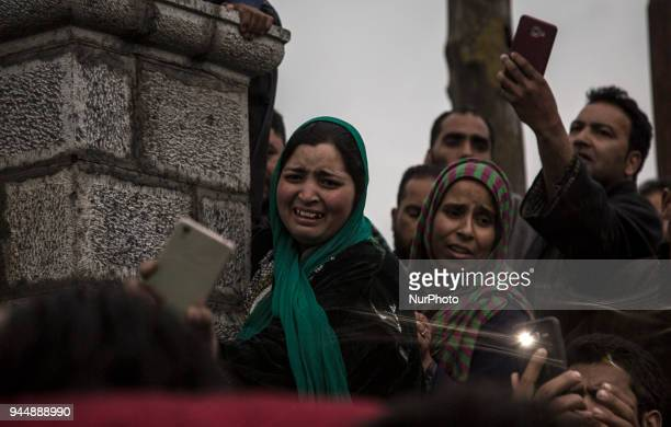Kashmiri women cry during the funeral procession of Sharjeel Sheikh a civilian who was shot dead by Indian government forces during clashes near the...