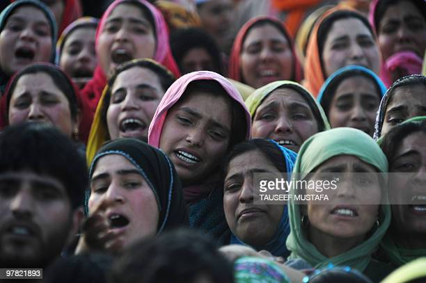 Kashmiri women cry near the body of civilian Khursheed Ahmad at his funeral in Hawoora village in Budgam district on April 16, 2010. Khursheed was...