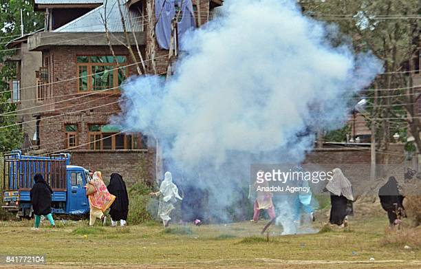 Kashmiri women devotees run after Indian paramilitary forces fired tear gas canisters during an antiIndia protest after Eid alAdha prayer in Srinagar...