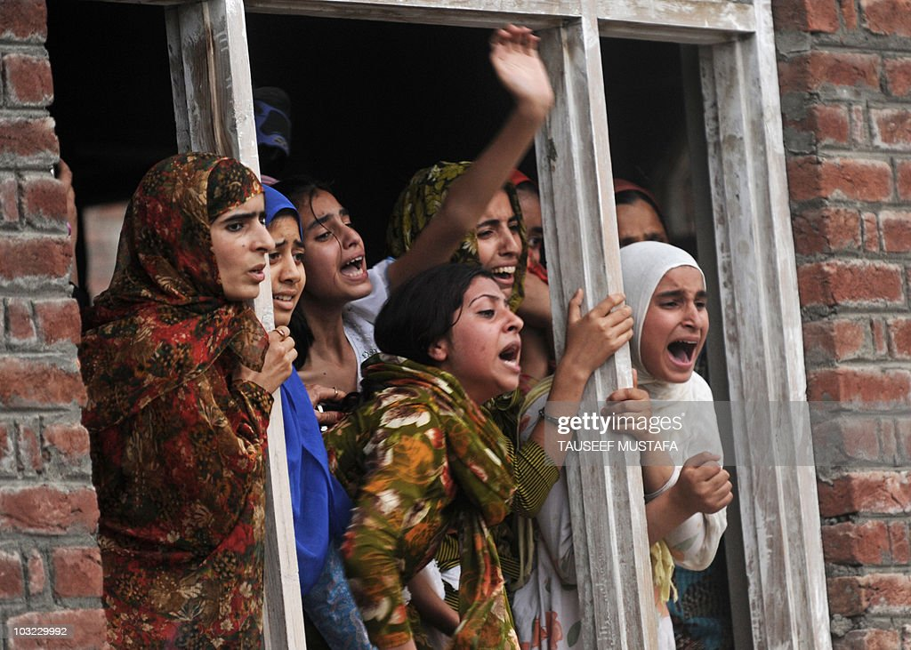 Kashmiri women gesture as they look from : News Photo