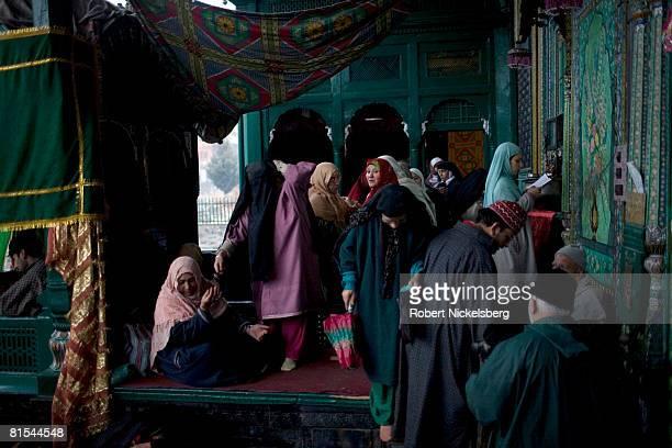Kashmiri women leave after praying outside the elaborately decorated Shah-i-Hamadan shrine on January 16, 2008 in Srinagar, Kashmir. The wooden...
