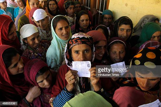 Kashmiri women lineup to cast their votes during the eighth phase of voting of the Parliamentary Elections at Lach Langate on May 7 2014 in Kupawara...