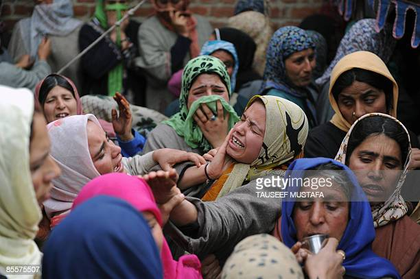 Kashmiri women mourn during the funeral of slain Indian Army soldier Shabir Ahmed Maliks at Dab Wakoora Northeast of Srinagar on March 24 2009 An...