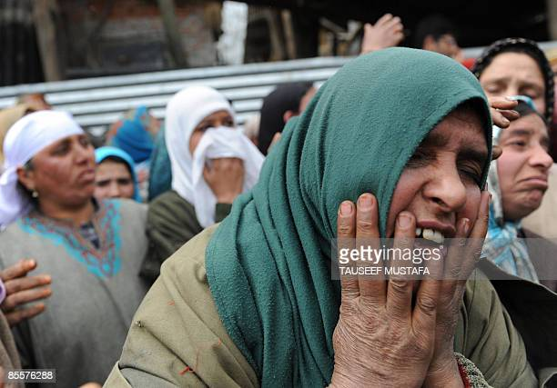 Kashmiri women mourn during the funeral of slain Indian army soldier Shabir Ahmed Malik at Dab Wakoora northeast of Srinagar on March 24 2009 An army...