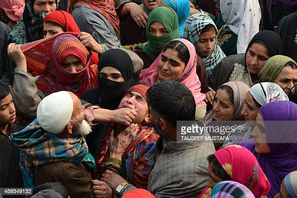 Kashmiri women mourn Shiraz Ahmed a suspected rebel during his funeral procession in the village of Panjran in Pulwama District south of Srinagar on...