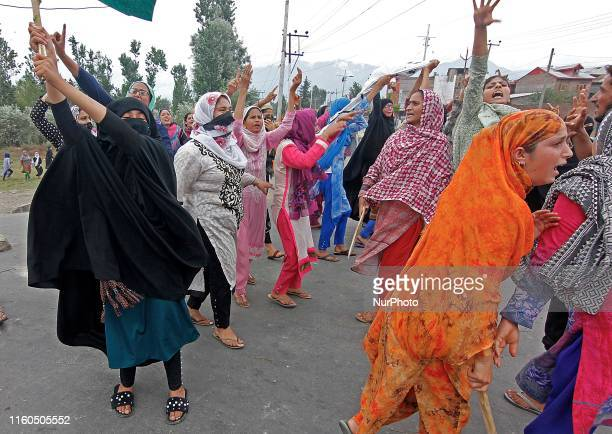 Kashmiri women shout pro freedom slogans as they run for safer places after Indian forces fire teargas shells on people who were protesting against...