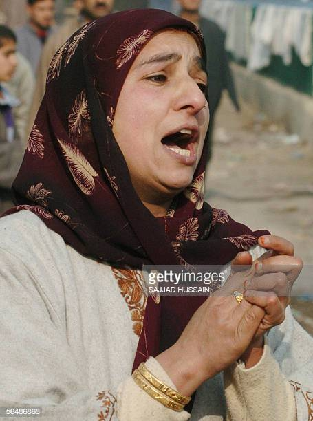 Kashmiri women wails at the scene of an encounter in which two houses were reduced to rubble during a firefight between Islamic rebels and Indian...