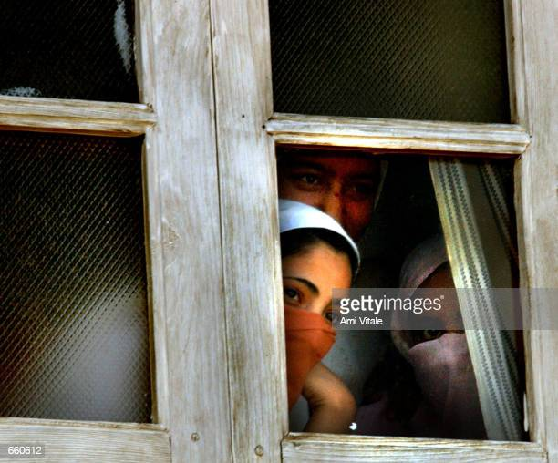 Kashmiri women watch the funeral of Fayez Ahmed Lone on June 7 2002 in Srinagar the summer capital of the Indian held state of Jammu and Kashmir Lone...