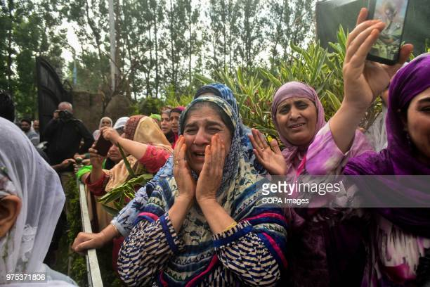 Kashmiri women weep during the funeral procession of Shujaat Bukhari veteran journalist and EditorinChief of English daily 'Rising Kashmir' in Kreeri...