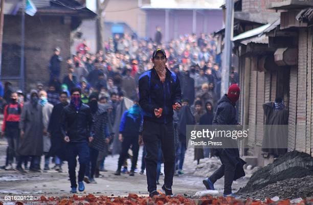 Kashmiri young masked protester throwing stones towards security forces Soon after Friday prayers youth assembled near Jamia Masjid sopore some 55...