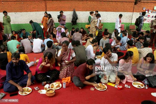 Kashmiri youth and volunteers have food during a gathering titled as ' Eid away from home' to celebrate Eid alAdha at Jantar Mantar in New Delhi on...