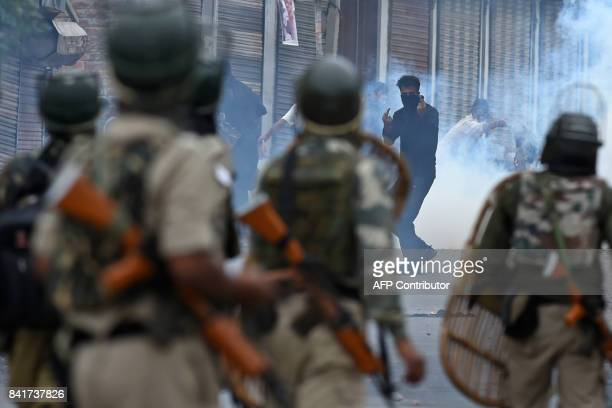 A Kashmiri youth gestures during clashes between protesters and Indian government forces in downtown Srinagar on September 2 2017 Clashes broke out...