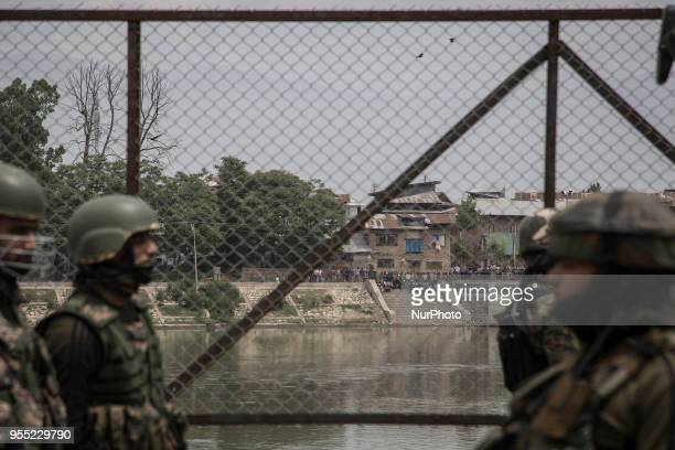 Kashmiri youth protest across the river near the gunfight site Saturday May 5 in Srinagar Indiancontrolled Kashmir Three rebels were killed in a...