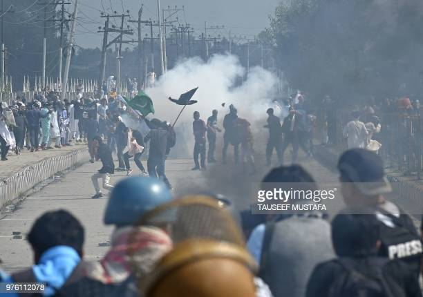 TOPSHOT Kashmiri youths through stones during clashes between protesters and Indian government forces in Srinagar on June 16 2018 Clashes broke out...