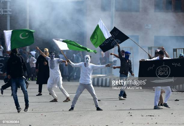 Kashmiri youths waves Pakistan national flags and Islamic State group flags during clashes between protesters and Indian government forces in...