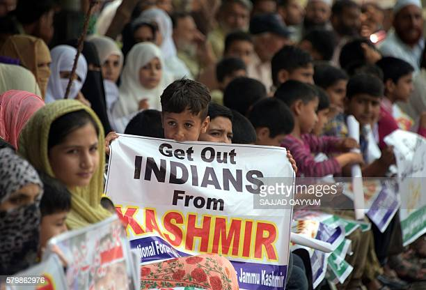 Kashmiris hold placards during an antiIndian protest in Muzaffarabad the capital of Pakistanadministered Kashmir on July 25 against killings in...