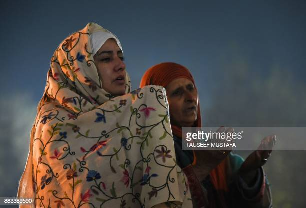 Kashmiris offer prayers before a priest displays a relic believed to be a hair from the beard of Prophet Muhammed during EideMiladunNabi the birthday...