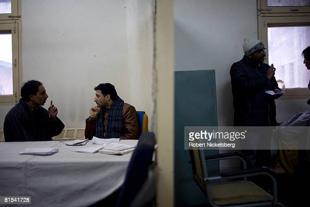 Kashmiris see a government psychiatrist, Dr. Arshad Hussain, center, at the Out Patient Department of the Sri Maharaja Hari Singh, SMHS, hospital on...