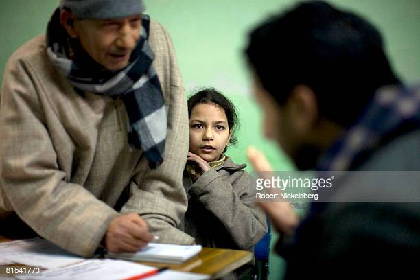 Kashmiris see a government psychiatrist Dr Arshad Hussain right at the Out Patient Department of the Psychiatric Hospital January 14 2008 in Srinagar...