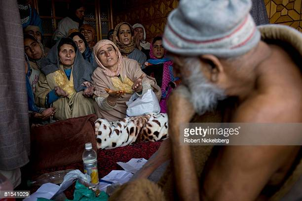 Kashmiris sit inside the house of Ahad Sahib, a 72 year-old peer or holy man on January 13, 2008 in Sopore, Kashmir. Hundreds of Kashmiris throng to...