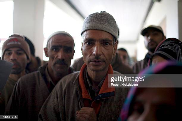Kashmiris wait to see a government psychiatrist at the Out Patient Department of the government run Psychiatric Hospital on January 14, 2008 in...