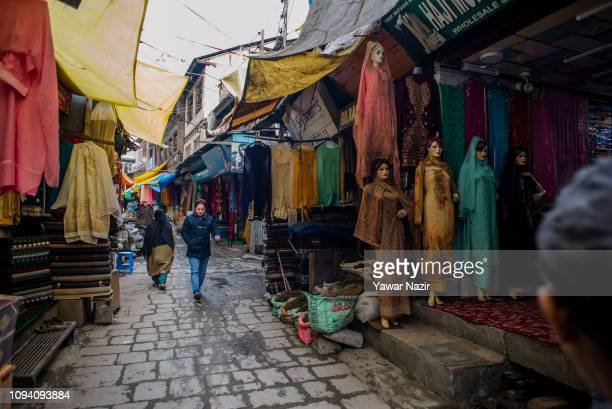 Kashmiris walk in an alleyway in the old city on February 05 2019 in Srinagar the summer capital of Indian administered Kashmir India Kashmir the...
