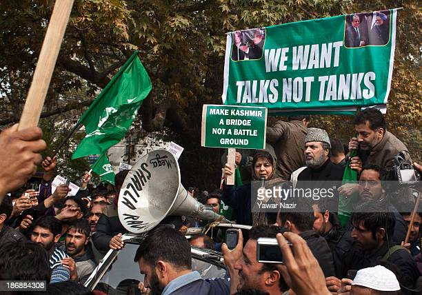 Kashmir's main opposition political party Peoples Democratic Party's leader Mehbooba Mufti along with other leaders of PDP hold a placard during a...