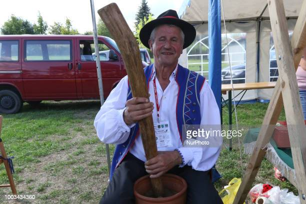 Woman taking snuff from traditional Kashubian snuff box made of cow horn is seen in Chmielno Kashubia region Poland on 21 July 2018 Kashubs or...