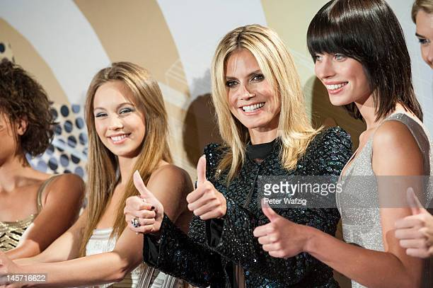 Kasia Lenhard Heidi Klum and SarahAnessa Hitzschke attend the Germany's Next Topmodel Finalists Photocall at the LanxessArena on June 04 2012 in...