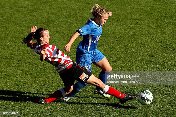 Kasia Lipka of Doncaster Rovers Belles and Isobel Christiansen of Birmingham City Ladies during the FA WSL match at Keepmoat Stadium on September 29,...