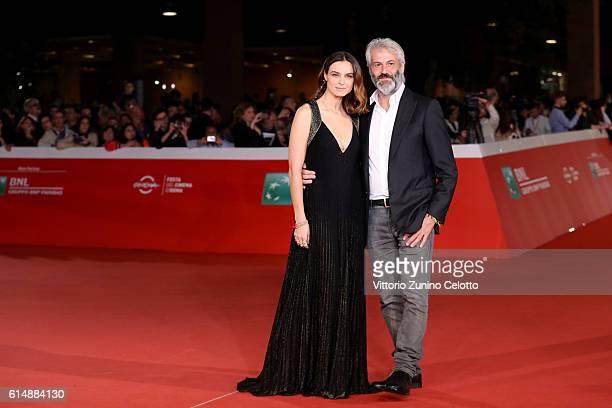 Kasia Smutniak and Domenico Procacci walks a red carpet for 'Sole Cuore Amore' during the 11th Rome Film Festival at Auditorium Parco Della Musica on...