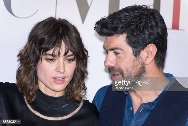 Kasia Smutniak and Pierfrancesco Favino attend a photocall for 'Moglie E Marito'