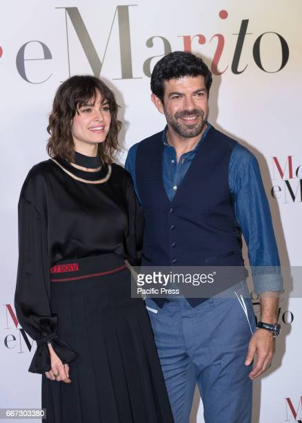 Kasia Smutniak and Pierfrancesco Favino attends a photocall for 'Moglie E Marito'