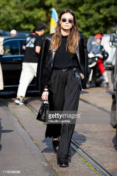 Kasia Smutniak, wearing a black leather jacket Saint Laurent blouse, is seen outside the Tod's show during Milan Fashion Week Spring/Summer 2020 on...