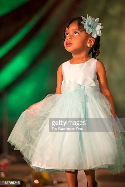 KaSiah Clark 2 of Severn Maryland takes a look upward from the runway in the 3rd Annual Glynn Jackson's Show Biz Kidz at The Silver Spring Civic...