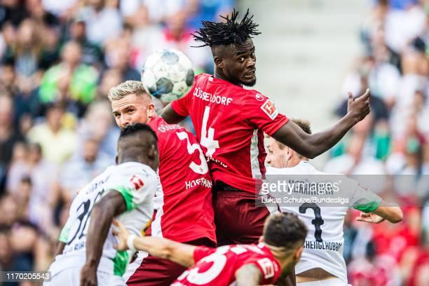 Kasim Adams of Düsseldorf and Andre Hoffmann of Düsseldorf in action during the Bundesliga match between Borussia Mönchengladbach and Fortuna...