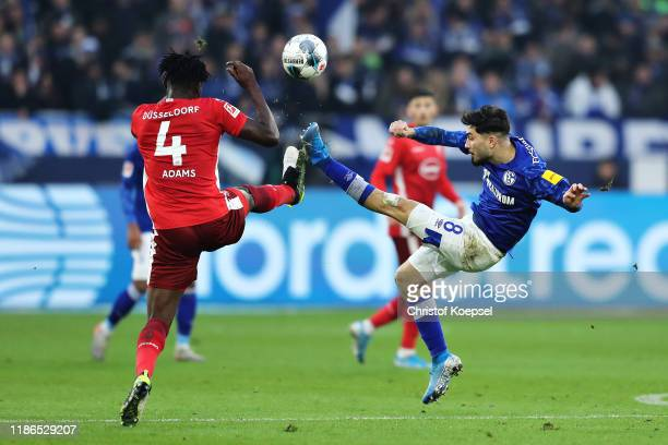 Kasim Adams of Fortuna Dusseldorf and Suat Serdar of FC Schalke 04 battle for the ball during the Bundesliga match between FC Schalke 04 and Fortuna...