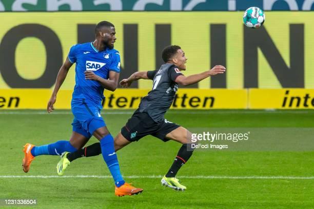 Kasim Adams of TSG 1899 Hoffenheim and Felix Agu of SV Werder Bremen battle for the ball during the Bundesliga match between TSG Hoffenheim and SV...