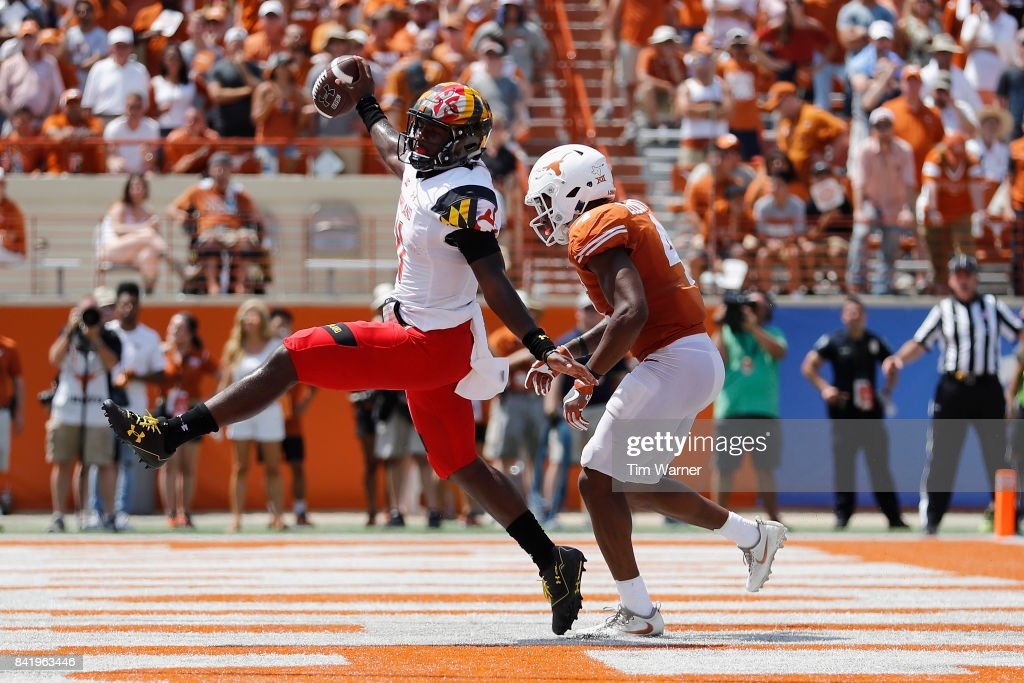 Kasim Hill #11 of the Maryland Terrapins rushes for a touchdown past DeShon Elliott #4 of the Texas Longhorns in the fourth quarter at Darrell K Royal-Texas Memorial Stadium on September 2, 2017 in Austin, Texas.