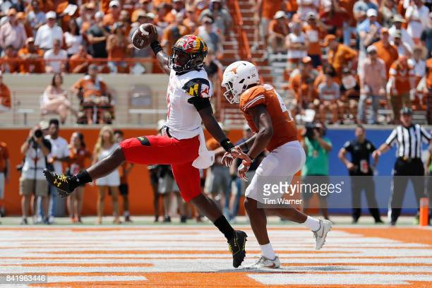 Kasim Hill of the Maryland Terrapins rushes for a touchdown past DeShon Elliott of the Texas Longhorns in the fourth quarter at Darrell K RoyalTexas...