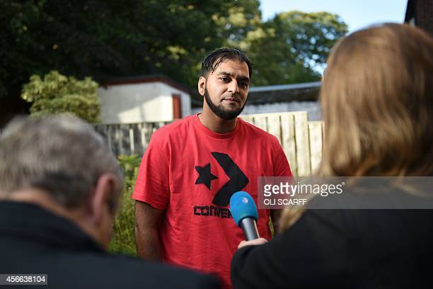 Kasim Jameel an humanitarian aid convoy leader and friend of murdered British aid worker Alan Henning addresses members of the media from his home in...