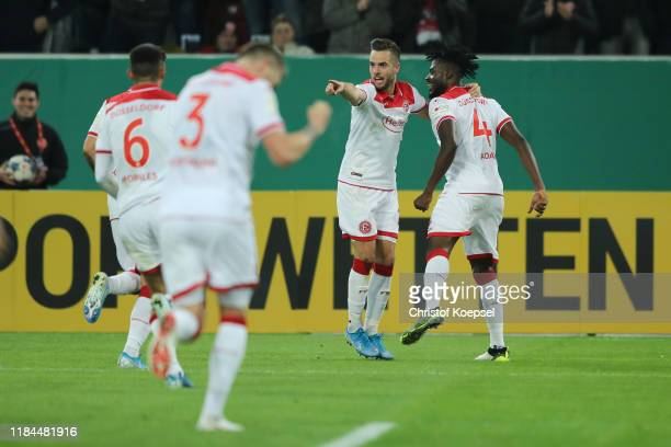 Kasim Nuhu of Fortuna Duesseldorf celebrates with teammates after scoring his sides second goal during the DFB Cup second round match between Fortuna...